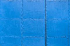 蓝色金属门 免版税库存照片