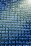 蓝色钢位子的样式在体育场内 免版税库存照片