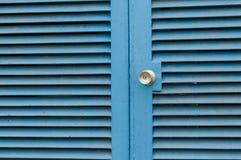 蓝色钢门 免版税库存图片