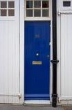 蓝色门前面 免版税库存照片
