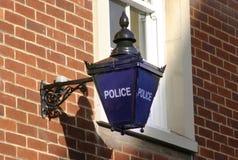 蓝色闪亮指示警察签字 库存照片