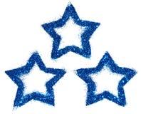 蓝色闪烁三个抽象星在您的设计的白色背景闪耀 免版税库存图片