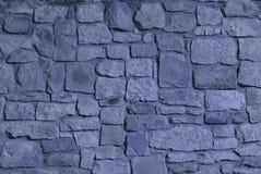蓝色颜色石墙 库存图片