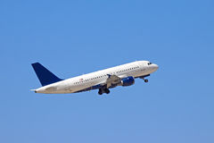 蓝色飞行喷气机天空 库存照片