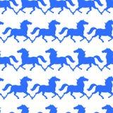 蓝色马无缝的样式 免版税库存图片
