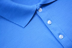 蓝色马球T恤杉 图库摄影