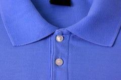 蓝色马球T恤杉 库存图片