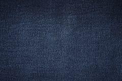 蓝色黑暗的牛仔裤纹理 免版税库存照片