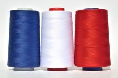 蓝色,白色和红色螺纹 库存照片