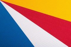 蓝色,红色,黄色,成波状的白色 免版税库存照片