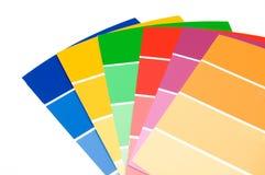 蓝色,绿色,红色,黄色被隔绝的油漆样品 免版税库存照片