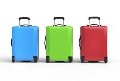蓝色, freen和红色塑料行李手提箱-后面看法 免版税库存照片