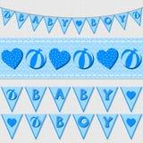 蓝色婴儿男孩旗子和丝带旗布集合 库存照片