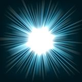 蓝色轻发光从黑暗背景 图库摄影