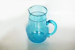 蓝色水晶玻璃瓶子,被隔绝 免版税库存图片