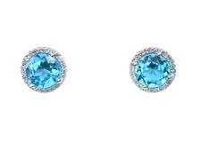 蓝色黄玉宝石和金刚石耳环坐垫用光晕设置切开了 库存图片