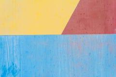 蓝色黄色和红色老金属背景纹理 库存图片