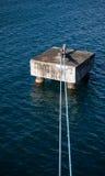 蓝色绳索被栓对具体船停泊 库存图片