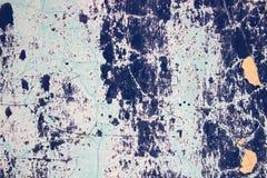 蓝色破裂的墙壁 库存图片