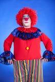 蓝色backgound的小丑 库存照片