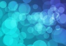 蓝色Bokeh轻的背景 免版税库存图片