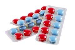 蓝色boundle查出的红色片剂 免版税图库摄影