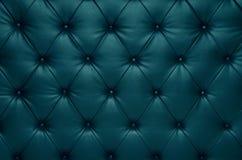 蓝色capitone方格的教练皮革装饰 库存图片