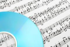 蓝色CD的音乐附注 免版税库存图片