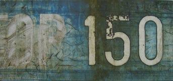 蓝色grunge隐藏的编号白色字 免版税库存图片