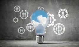 蓝色skyscape和云彩在电灯泡里面 免版税库存图片