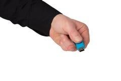 蓝色USB棍子在手上,隔绝在白色 免版税库存照片