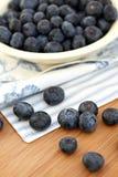 蓝莓溢出了 库存照片