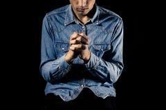 蓝领工人祈祷 免版税库存照片
