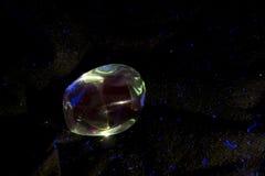 蓝绿色萤光矿物样品  图库摄影