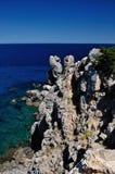 蓬塔Faraglione与岩石峭壁的海景, Giglio海岛,意大利 库存图片