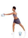 蓬松卷发妇女锻炼 免版税库存照片