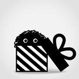 蓬松滑稽的妖怪从礼物盒出来 也corel凹道例证向量 免版税库存照片