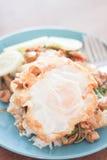 蓬蒿鸡蛋油煎的猪肉米 库存图片