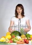 蔬菜水果商购物 免版税库存图片