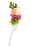 蔬菜,干酪,在叉子的荷兰芹。 免版税库存照片