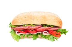 蕃茄、蒜味咸腊肠和胡椒三明治 免版税库存图片