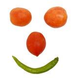 蕃茄和智利面带笑容面孔 免版税图库摄影