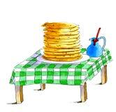 薄煎饼在桌上 免版税库存照片