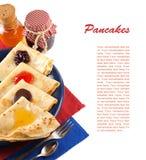 薄煎饼用果酱、蜂蜜和巧克力。 库存图片