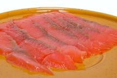 薄片红色鱼在牌照位于 图库摄影