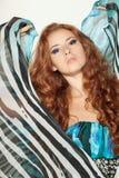 薄绸礼服时装模特儿摆在 免版税图库摄影