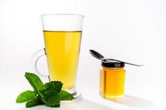 薄荷的茶和蜂蜜 库存图片