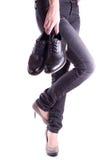 藏品人对s穿上鞋子妇女 免版税库存照片