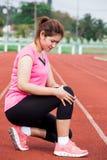 藏品伤害膝盖痛处妇女 免版税库存图片