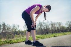 藏品伤害膝盖痛处妇女 免版税图库摄影